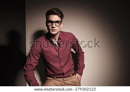 Portrait of a young casual business man looking at the camera while holding his hand in pocket.