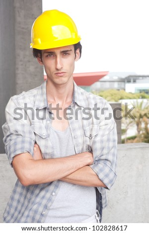 portrait of a young construction worker on location