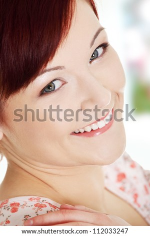 Portrait of a young happy woman