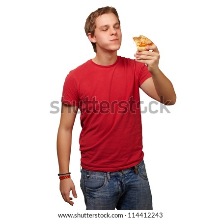 portrait of a young man eating pizza on a white background