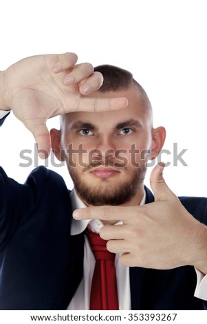 portrait of a young man in a suit making framing hand gesture on white background studio