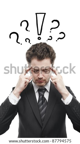 Portrait of a young man with exclamation mark and question marks above his head. Conceptual image of a open minded man.