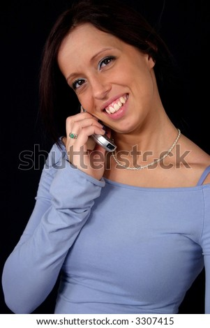 portrait of a young pretty woman isolated on with cellular phone