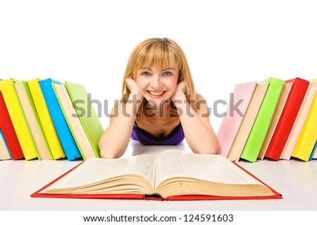 Portrait of a young student lying and reading a book. Wide angle. Isolated
