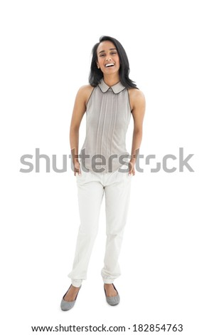 Portrait of a young woman laughing over white background