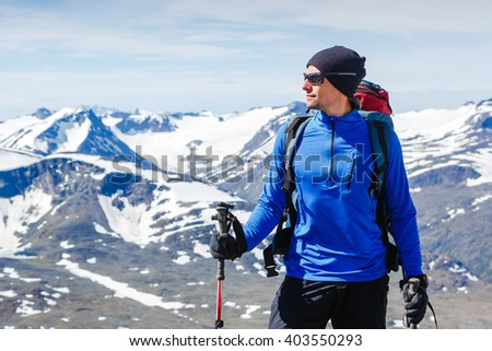 portrait of adventure man with backpack in the mountains