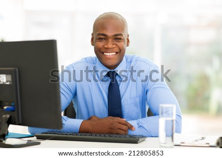 portrait of african businessman sitting in office