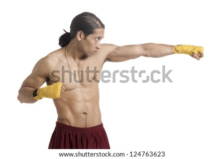 Portrait of aggressive boxer on punching stance against white background