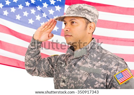 portrait of american soldier saluting on us flag background