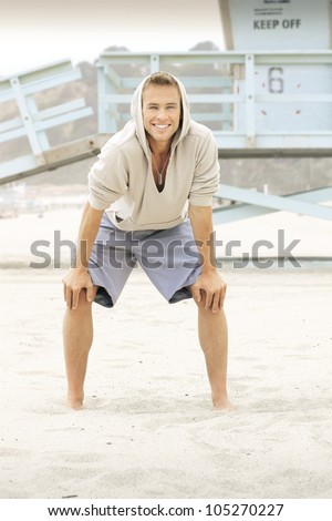 Portrait of an active young guy at the beach