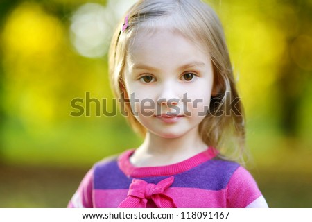 Portrait of an adorable little girl at autumn
