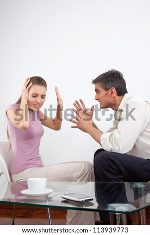 Portrait of an angry couple arguing.