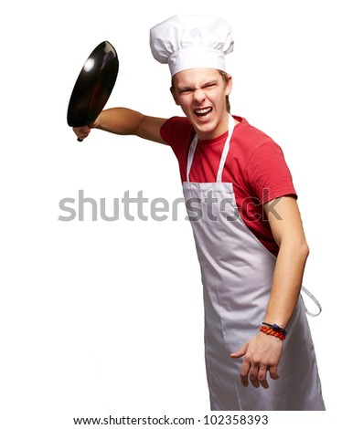 portrait of an angry young cook man hitting with a pan over a white background