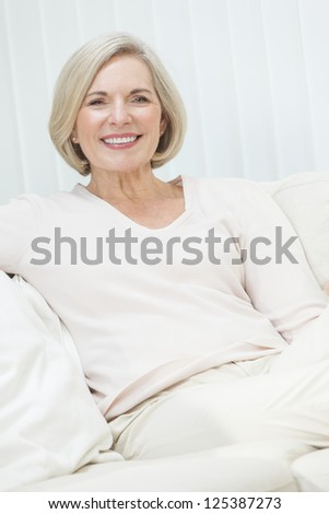 Portrait of an attractive elegant senior woman sitting relaxing at home.