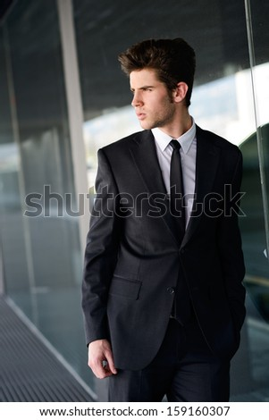 Portrait of an attractive young businessman in urban background
