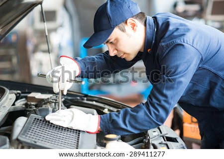 portrait auto mechanic work on car stock photo 258981092