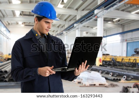 Portrait of an engineer using a laptop computer