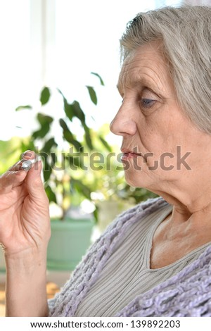 Portrait of an old woman feel unwell