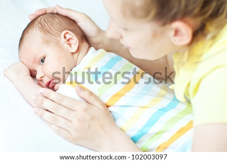 Portrait of angelic baby and his mother