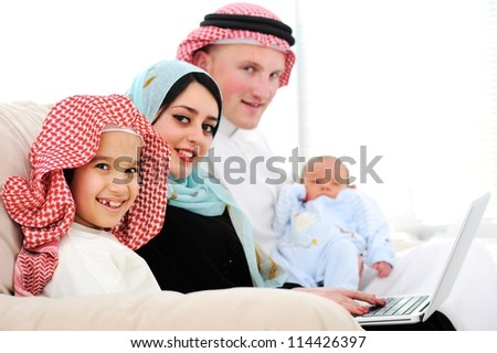 Portrait of Arabic family with new baby at home