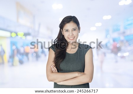 portrait of asian businesswomen has airport background ..Mixed Asian / Caucasian businesswoman.Positive emotion