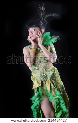 portrait of asian teenage girl dressing up in green kebaya modification on black background