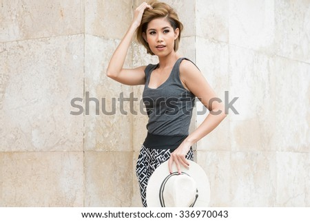 portrait of asian woman standing out door