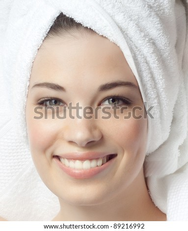 portrait of attractive  caucasian smiling woman isolated on white studio shot in towel