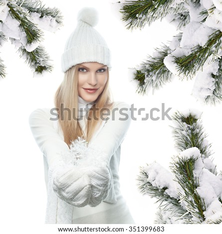 portrait of attractive  caucasian woman  with long blond hair in warm clothing  isolated on white studio shot looking at camera christmas tree snow covered new year