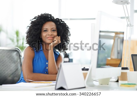 Portrait of attractive confident business lady at her workplace