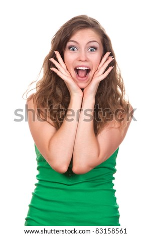 portrait of attractive surprised excited smile teenage girl wear green shirt, with white teeth, brown long hair, isolated over white background concept of happy student, young pretty woman