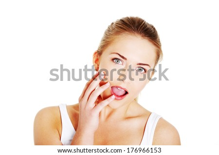 Portrait of attractive, surprised ,excited ,smiling teenage girl with mouth open, isolated over white background.