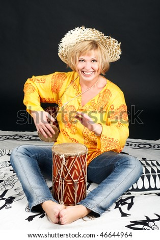 Portrait of attractive woman with drums.