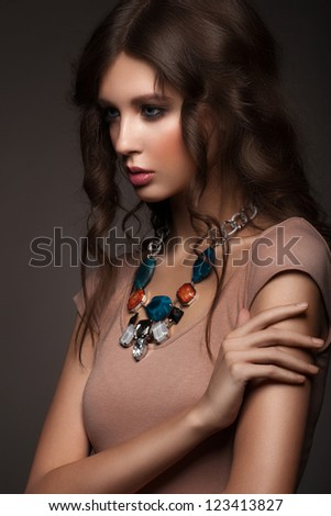 Portrait of attractive young woman with beautiful necklace