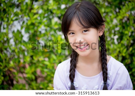 Portrait of beautiful Asian girl smiling in the garden