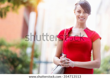 Portrait of beautiful business woman in red dress