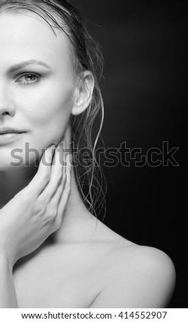 Portrait of beautiful caucasian blonde woman isolated on black background. Studio portrait. Black and white