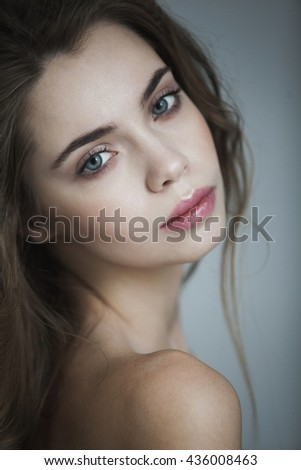 portrait of beautiful girl on blue background