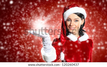 Portrait of beautiful girl wearing santa claus clothes on red background