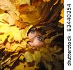 portrait of beautiful girl with autumn leaves - stock photo