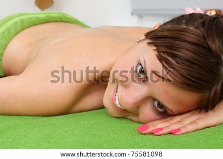 Portrait of beautiful lady relaxing after the massage