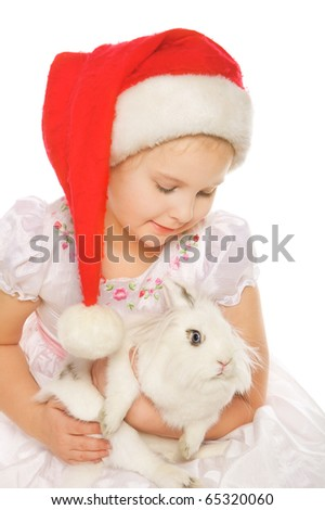 Portrait of beautiful smiling girl in red cap with small bunny