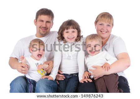 Portrait of beautiful smiling happy family of five - isolated over a white background