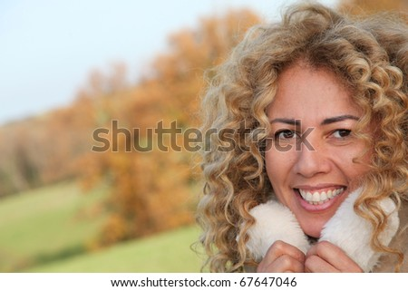 Portrait of beautiful smiling woman out in countryside