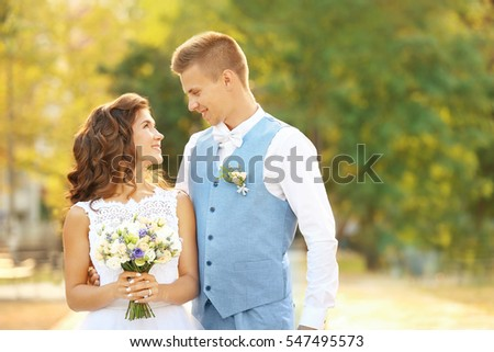 Portrait of beautiful wedding couple on blurred background