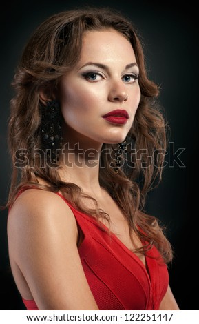 Portrait of beautiful woman in red dress with red lips