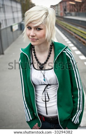 portrait of beautiful woman waiting for the train