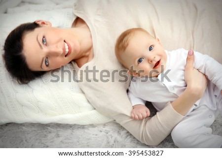 Portrait of beautiful woman with baby, close up