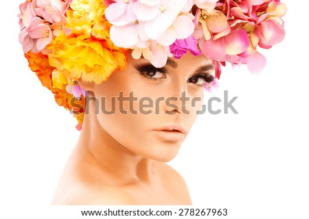 Portrait of beautiful woman with flower wreath. isolated on white