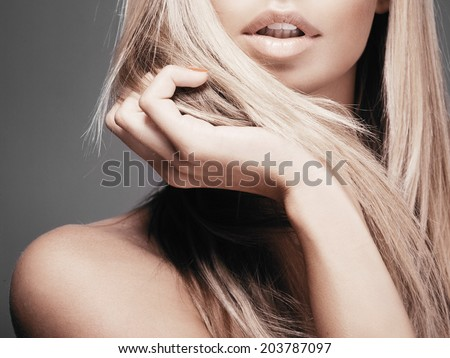 Portrait of beautiful woman with long blond hair